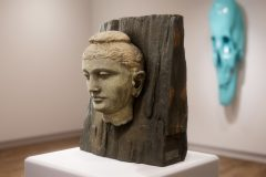 Buddha Head - schist on wood